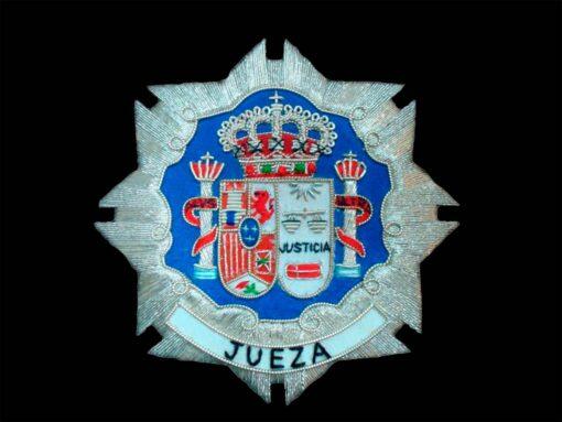 Escudo para toga jueza fondo negro