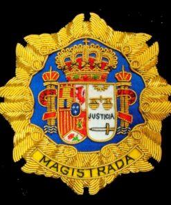 Escudo para toga magistrada justicia fondo negro